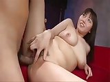 Busty Japanese lady having hot sex with young man