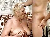 Lucky Pizzaboy fucks with busty grandma