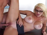 Horny busty teacher in glasses fucks in the classroom