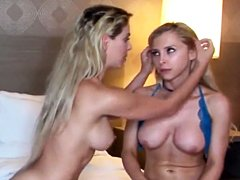 Two beautiful busty blondes in hot lesbian scene